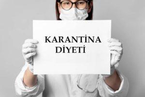 Elinde Karantina Diyeti yazan kağıdı tutan diyetisyen